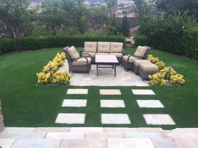 stepping stones landscape design with aritficial turf corona